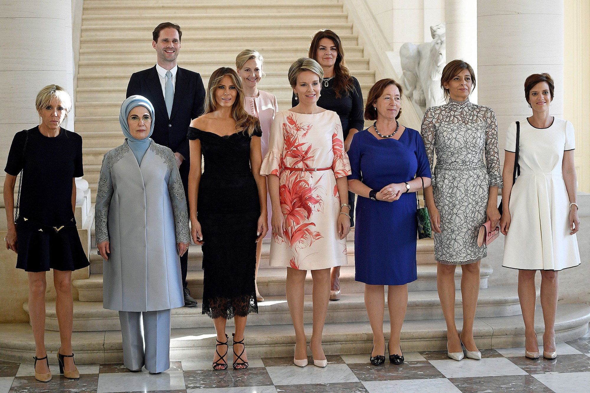 (Front row LtoR) First Lady of France Brigitte Macron, First Lady of Turkey Emine Gulbaran Erdogan, First Lady of the US Melania Trump, Queen Mathilde of Belgium, Stoltenberg's partner Ingrid Schulerud, Partner of Bulgaria's President Desislava Radeva, partner of Charles Michel Amelie Derbaudrenghien, (back row, LtoR) First Gentleman of Luxembourg Gauthier Destenay, partner of Slovenia's Prime Minister Mojca Stropnik and First Lady of Iceland Thora Margret Baldvinsdottir pose for a family photo before a diner of the First Ladies and Queen at the Royal castle in Laken/Laeken, on May 25, 2017, in Brussels. / AFP PHOTO / BELGA / YORICK JANSENS / Belgium OUT (Photo credit should read YORICK JANSENS/AFP/Getty Images)